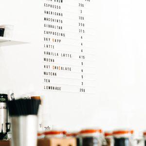 coffee shop menu on white wall