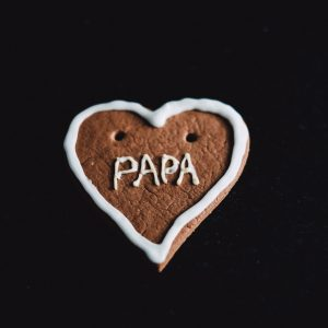 heart-shaped cookie with papa decoration