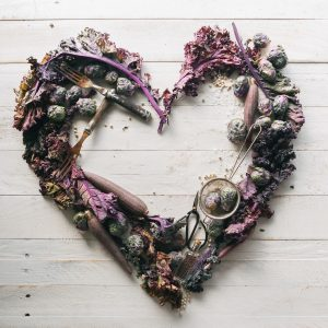 top view of leaves and assorted items formed into heart